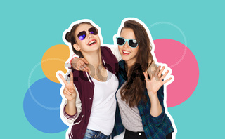 two smiling teenage girls in sunglasses