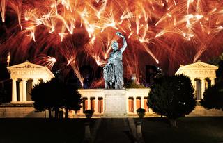 Fireworks at the illuminated Bavaria sculpture in Munich