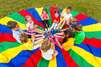 Kids clap the hands in the summer outdoors