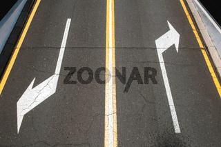 left / right, direction arrows on asphalt road