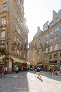 tourists enjoy exploring the old town center in Saint-Malo in Normandy during summer vacation