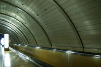 Moscow metro, escalator, rhythm of repeating design elements and lamps
