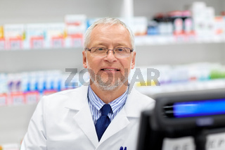 senior apothecary at pharmacy cash register