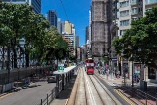 Street Scenario view on a Hongkong Street with Tramway, Pedestrians and Traffic. In Yau Tsim Mong, Hong Kong, China