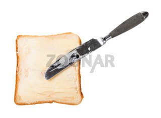 knife and open sandwich with toast and butter