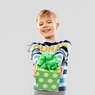 smiling boy with birthday gift box