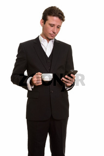 Handsome Caucasian businessman using mobile phone while holding