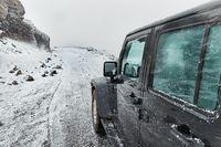 Car on Icelandic snowy terrain