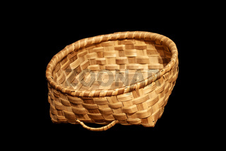 Traditional wicker basket isolated on black background
