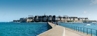historic French town of Saint-Malo in Normandy seen from the harbor wall jetty