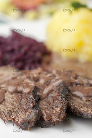 Rhenish Sauerbraten with red cabbage on a plate