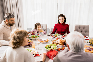 Young Woman Enjoying Family Dinner