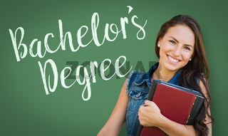 Bachelors Degree Written On Chalk Board Behind Mixed Race Young Girl Student Holding Books