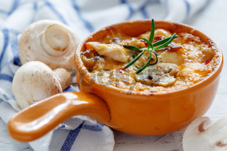 Clay pot with fried mushrooms,chicken and cheese.