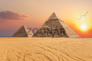 The Pyramid of Chephren and the Pyramid of Cheops, beautiful sunset view of Giza, Egypt
