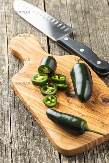 Sliced green jalapeno pepper.