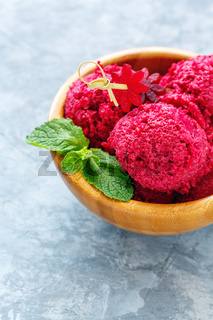 Homemade beetroot ice cream in a wooden bowl.