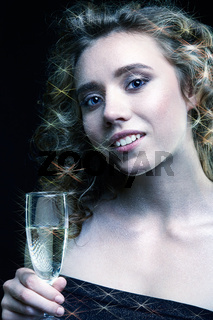 Girls with glass of champagne in hand