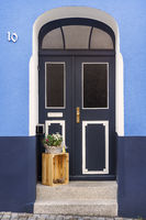 Blue house with door