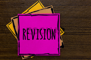 Writing note showing Revision. Business photo showcasing Rechecking Before Proceeding Self Improvement Preparation Three art small paper two yellow one pink wood brown lite grey shadow.