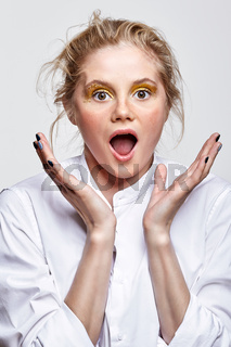 Female with expression of surprise on face.