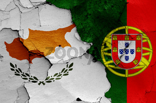 flags of Cyprus and Portugal painted on cracked wall
