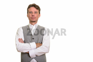 Handsome formal Caucasian man wearing vest with arms crossed