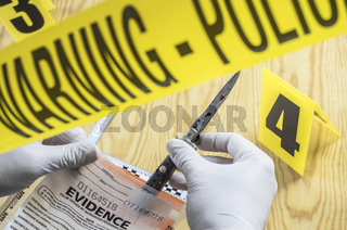 Scientist examines tests of cutting weapon of crime in a laboratory, conceptual image
