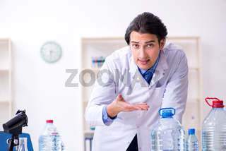 Young male chemist experimenting in lab