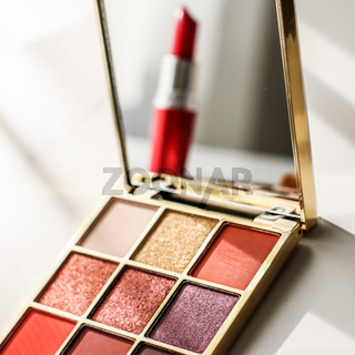 Cosmetics, makeup products set on marble vanity table, lipstick, eyeshadows and make-up brush for luxury beauty and fashion brand ads, holiday design