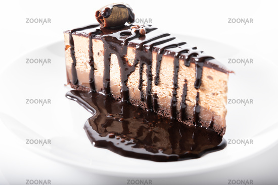 Chocolate cake with chocolate sauce, close up on white background