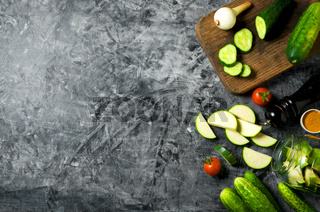 Vegetables on the background. Fresh vegetables (cucumbers, tomatoes, onions, garlic, dill, green beans) on a gray background. Top view. Copy space