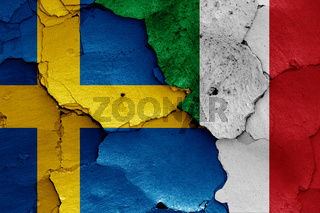 flags of Sweden and Italy painted on cracked wall