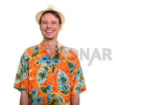 Happy Caucasian man ready for vacation looking at camera