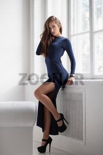 Alluring brunette posing standing in a studio.