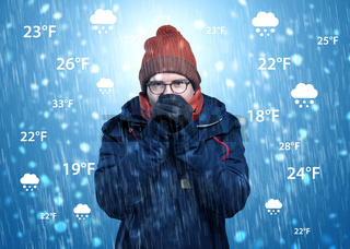 Boy freezing in warm clothing with weather condition concept