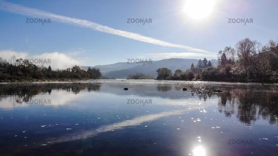 Beautiful autumn nature in Carpathians, Ukraine. Mountain river Stryi, sunny weather and blue sky
