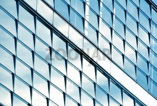 Modern business office building blue glass windows