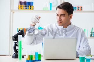 Male chemist working in lab