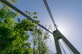 Modern Bridge against a blue sky with the sun behid