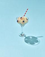 Glass with Halloween cocktail with human eyeballs.