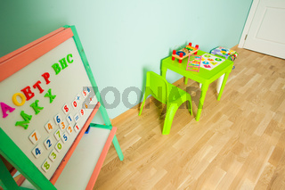 Magnetic board with letters in the modern playroom