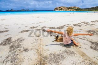 Woman with kangaroo at Lucky Bay