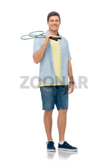 smiling young man with badminton rackets