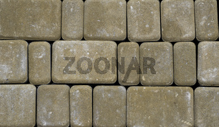 Concrete or cobble gray pavement slabs or stones for floor, wall or path. Traditional fence, court, backyard or road paving. Brick Stone Pavement for a the street road, parks, sidewalks.