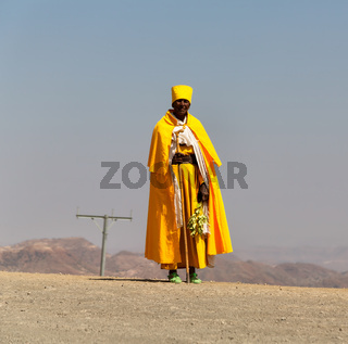 ethiopia  in the street mountain a  priest walking