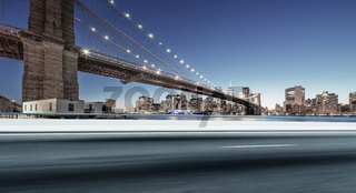 asphalt highway  with cityscape of manhattan