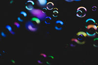 Colorful bubbles over dark background