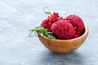 Artisanal beetroot ice cream in a wooden bowl.