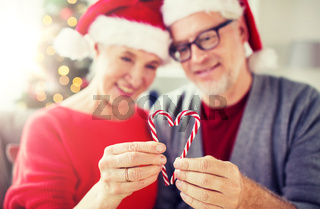 senior couple with heart of christmas candy canes